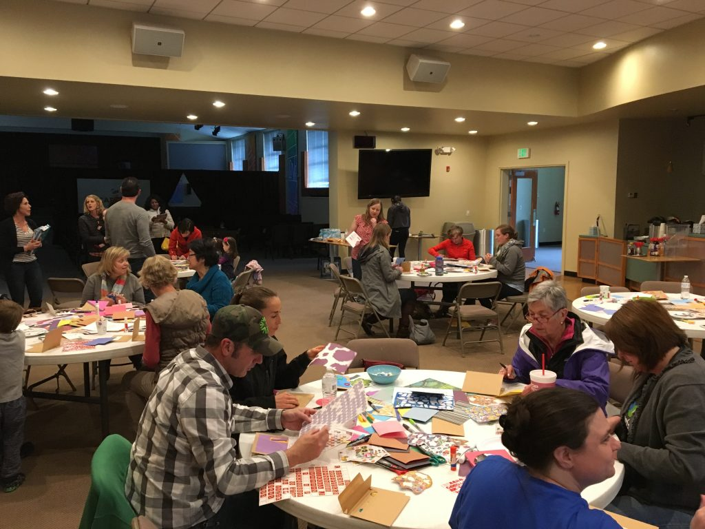 Capital friends crafting love cards to send to Swaziland